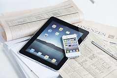 iPad, iPhone auf Finanzzeitung
